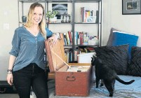 ??  ?? Dana Smith in her Vancouver condo with the travel chest that she inherited from her Doukhobor family.