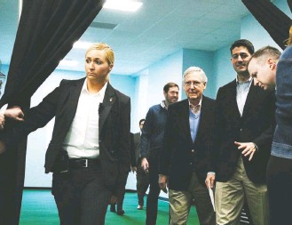 """?? ALEX WONG/GETTY IMAGES ?? Senate Majority Leader Mitch McConnell (R-Ky.), center, and House Speaker Paul D. Ryan (R-Wis.) arrive for a news briefing during a Republican retreat at the Greenbrier resort. """"I don't think we'll see a threatened government shutdown again over this..."""