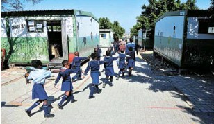 ??  ?? Pupils make do at the old Mayibuye Primary School in Midrand.