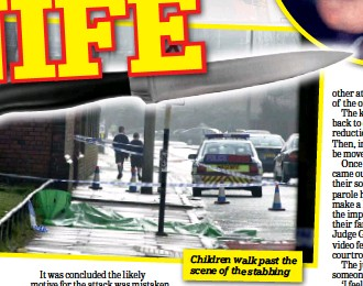 ??  ?? Children walk past the scene of the stabbing