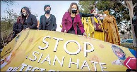 ?? Apu Gomes AFP via Getty Images ?? PROTESTERS call for an end to violence Wednesday in Garden Grove.