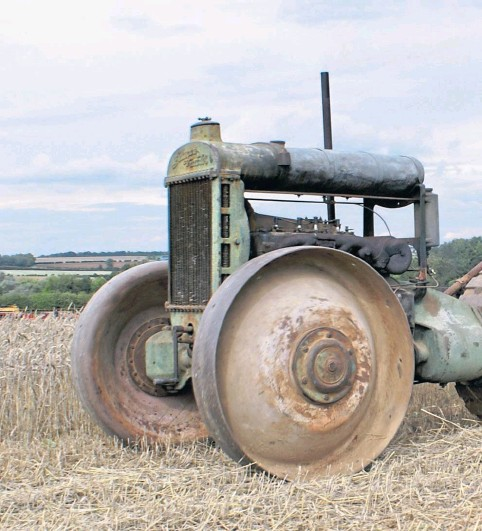??  ?? TIME MACHINE: A Glasgow tractor at a demonstration day shows how the three-wheeled design meant a clean field would be