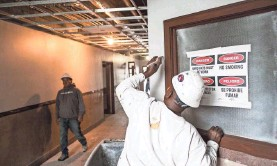 ?? THE COMMERCIAL APPEAL ?? Workers are busy inside the Universal Life Insurance building. Self+Tucker Architects and the City of Memphis Business Development Center are expected to move into 480 Dr. Martin Luther King Blvd. this spring. BRAD VEST /