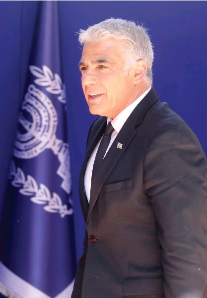 ?? (Marc Israel Sellem/The Jerusalem Post) ?? FOREIGN MINISTER Yair Lapid arrives at the President's Residence on Sunday.