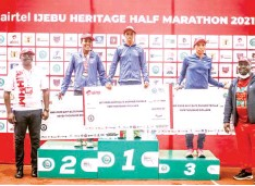 ??  ?? Winners displaying their replica cheques at the end of the Airtel Ijebu Half Marathon… at the weekend