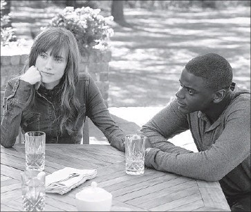 """?? Justin Lubin Universal Pictures ?? """"GET OUT,"""" about a young black man (Daniel Kaluuya, right) whose trip to meet the parents of his white girlfriend (Allison Williams, left) turns deeply sinister, has received unanimous praise from film critics."""