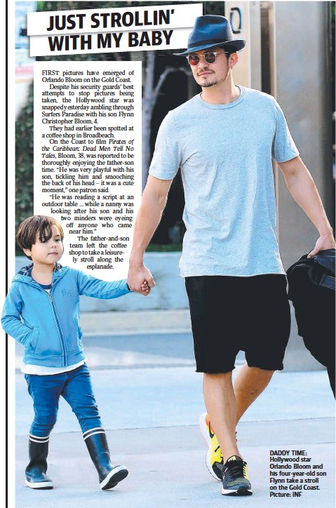 ??  ?? DADDY TIME: Hollywood star Orlando Bloom and his four-year-old son Flynn take a stroll on the Gold Coast. Picture: INF