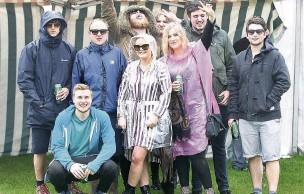 ??  ?? Having fun despite the rain at the Headlander Festival