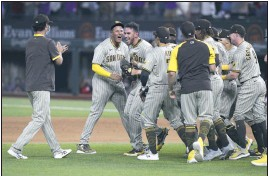 ?? AP PHOTO ?? San Diego pitcher Joe Musgrove (44) is mobbed by teammates after Friday's no-hitter against Texas.
