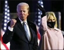 ?? PAUL SANCYA — THE ASSOCIATED PRESS ?? Democratic presidential candidate Joe Biden arrives to speak to supporters Wednesday in Wilmington, Del., as Jill Biden looks on.