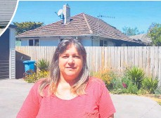 ?? Photo / Laura Wiltshire ?? Neighbour Karen Spurgeon in front of her neighbours' house. Her own home escaped damage-free.