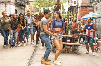 """?? Macall Polay / Warner Bros. ?? The film version of LinManuel Miranda's stage musical """"In the Heights,"""" directed by John M. Chu, will play on opening night at S.F.'s Vogue Theater."""