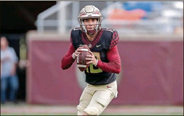 ?? DON JUAN MOORE | FSU Sports Information ?? FSU's McKenzie Milton, a graduate transfer from UCF, looks downfield during Saturday's spring game in Tallahassee.