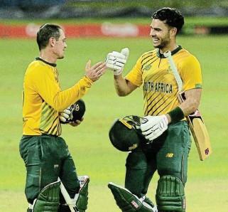 ?? /Isuru Sameera /Gallo Images ?? That winning feeling: SA openers Quinton de Kock, left, and Reeza Hendricks celebrate the Proteas' 10-wicket win over Sri Lanka.