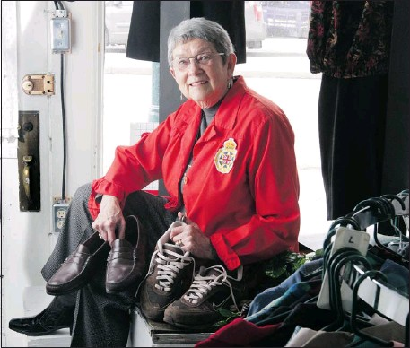 ?? Christina Ryan, Calgary Herald ?? Alma Rutledge, a member of iODE, shows some of the shoes being collected for donation to local ERs at the iODE bargain shop Offbeat Outfitters.