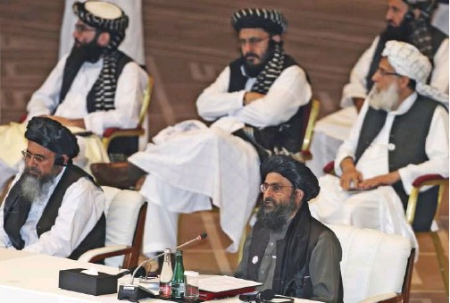 ?? File/associated Press ?? Taliban co-founder Mullah Abdul Ghani Baradar speaks (bottom right) at the opening session of the peace talks between the Afghan government and the Taliban in Doha, Qatar.