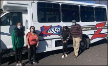 ??  ?? The Zuber Realty bus recently delivered bags of food and essentials to Preston's Pantry in Boyertown and Open Door Ministry in Royersford. Far right is owner Richard Zuber with staff or volunteers from Open Door Ministry.