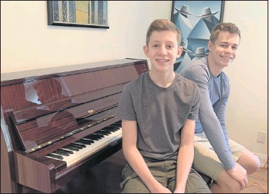 """?? ANDREA CORDERO FAGE ?? Andrea Cordero Fage says her sons Noah (left), 14, and Rafael, 16, """"came into their ownmusically"""" during the pandemic lockdown. They researchedmovie soundtracks and learned scores on their ownwith the assistance of sites like YouTube."""