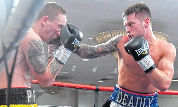 ?? Photographs by Chris Sumner ?? TOP FORM: Deadly Dean Sutherland lands a strong right on his opponent Edvinas Puplauskas of Lithuania – despite fighting a cold.