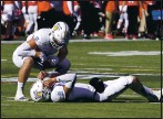 ?? RICK SCUTERI — THE ASSOCIATED PRESS ?? San Jose State quarterbac­k Nick Starkel lies on his back after getting hit in the first half of the Arizona Bowl against Ball State on Thursday.