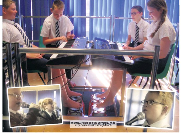 ??  ?? In sync... Pupils use the university kit to experience music through touch