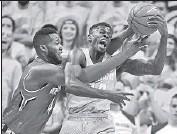 ?? Kirthmon F. Dozier Detroit Free Press ?? ERON HARRIS of Michigan State rebounds against Maryland's Robert Carter. The Spartans won, 74-65.