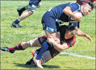?? KEITH GOSSE/THE TELEGRAM ?? The Atlantic Rock, shown here in this file photo of Mike Hamson tackling an Ontario Blues player last summer at the Swilers Rugby Complex, kick off their new Canadian Rugby Championship season today in Truro, N.S.