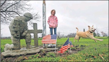 ?? [ToM DoDGE/DISPaTCH] ?? sarah Barnett stands by the memorial she created in who died of a drug overdose in december 2016. her garden to honor her partner Joseph kuhn,