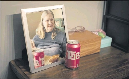 ?? CHICAGO TRIBUNE ?? Kathleen Berger drank several cans of TaB every day and sometimeswalked around the house singing the soda commercial's jingle, keeping her allegiance evenas TaB grewhard to find. After a stroke in her 50s, Berger's short- term memory grewfoggy, but when her kids offered her a TaB, the years snapped back into focus.