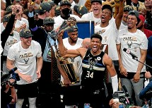 ?? AP ?? Milwaukee turned out in huge numbers to celebrate the success of their beloved Bucks. Left: Bucks forward Giannis Antetokounmpo said the NBA title vindicated his decision to stay with the team.