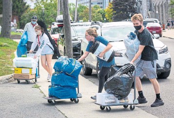 ?? LARS HAGBERG THE CANADIAN PRESS ?? Chatting in recent days with other people who are also adjusting to their kids' first week away from home reveals a range of coping skills, writes Brandie Weikle.