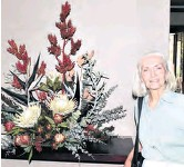 ??  ?? Dawn Dowell with her protea arrangement