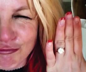 ??  ?? Diamond girl: The singer shows off £50,000 engagement ring