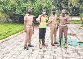 ??  ?? Surprise encounter: Personnel of the Tamil Nadu Fire and Rescue Services with a rescued snake.