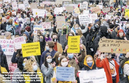 ??  ?? Some 2,000 people participat­e in a rally for equal rights and ratificati­on of the Istanbul Convention on Internatio­nal Women's Day in Kyiv on March 8, 2021.