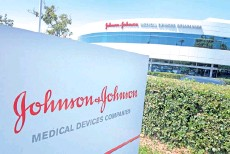 ?? — AFP photo ?? File photo shows an entry sign to the Johnson & Johnson campus in Irvine, California.