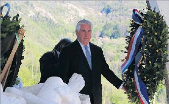 ?? Riccardo Dalle Luche/ANSA ?? U.S. Secretary of State Rex Tillerson paid tribute Monday at Sant'Anna di Stazzema, Italy, where Nazis massacred civilians during World War II. As he laid a wreath, he alluded to the Syria chemical attack.
