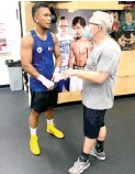 ?? (Courtesy of Sean Gibbons/MP Promotions) ?? Freddie Roach, right, and Eumir Felix Marcial.