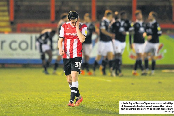 ?? Harry Trump ?? Josh Key of Exeter City reacts as Adam Phillips of Morecambe (not pictured) scores their sides first goal from the penalty spot at St James Park