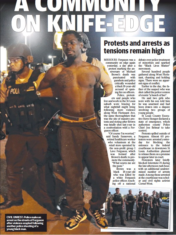 ??  ?? CIVIL UNREST: Police make an arrest on the streets of Ferguson after violence erupted following another police shooting of a young black man.