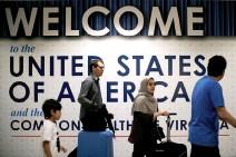 ?? REUTERS ?? INTERNATIONAL PASSENGERS arrive at Washington Dulles International Airport, Virginia, US, June 26, 2017.