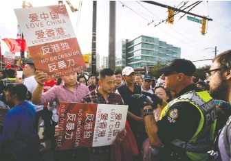 ?? DARRYL DYCK/THE CANADIAN PRESS ?? The battle between those who back the Chinese Communist government and those who oppose it has been heated in Vancouver over the years, and it seems to be ramping up again.