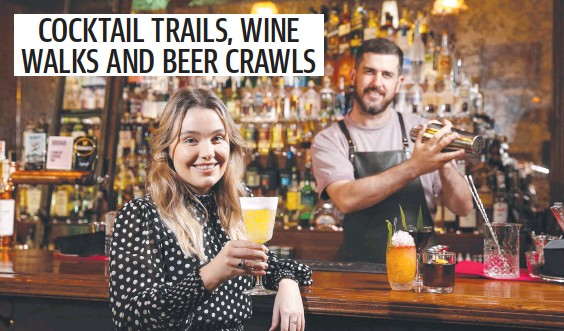 ??  ?? Maddy O'Reilly and Pete Hollands have a drink at The Gresham Bar in Brisbane's CBD ahead of the Dine BNE City campaign. Picture: Josh Woning