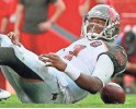 ?? KIM KLEMENT, USA TODAY SPORTS ?? Bucs QB Jameis Winston was sacked four times in a 42-14 loss to the Titans.