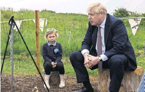 ??  ?? ▲ Boris Johnson on a visit yesterday to St Issey primary school, Wadebridge
