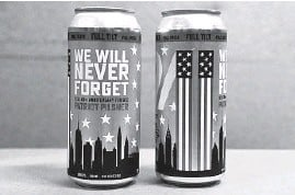 ?? BARBARA HADDOCK TAYLOR/BALTIMORE SUN ?? Full Tilt Brewing is canning their new beer, 911 Patriot Pilsner, at the brewery in Govans, as a 20th anniversary tribute to 9/11.