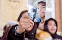 ?? CP FILE PHOTO ?? Debbie Baptiste, mother of Colten Boushie, holds up a picture of her son as she leaves the Court of Queen's Bench during a lunch recess on the fifth day of the trial of Gerald Stanley, the farmer accused of killing the 22-year-old Indigenous man, in Battleford on Feb. 5, 2018.