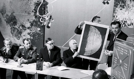 ??  ?? In February 1966, the Soviets announced at a press conference the first robotic soft landing on the moon, by Luna 9. At the time, Soviet achievements in space appeared to outpace the American program. Alexei Leonov (far left, sitting next to his friend Yuri Gagarin) was the frontrunner to make the first Soviet lunar landing, which was then at least two years off.