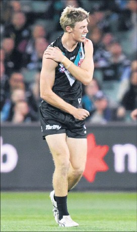 ??  ?? ■ Todd Marshall walks off the field after injuring his shoulder during Thursday night's qualifying final. Photo courtesy AAP Image/David Mariuz.