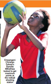 ??  ?? Empangeni Christian School's Bandile Mthethwa looked to get maximum points at the netball shooting station